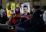Сторонники Мухаммеда Мурси во время акции в Каире. Фото AP Photo/Eman Helal